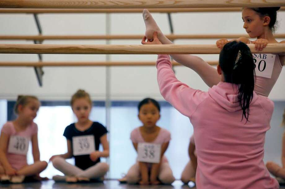 Taylor Harris, 5, right, auditions for the School of American Ballet, Monday, April 19, 2010 in New York. The audition was the first in a series conducted for students between the ages of 6 and 10.  (AP Photo/Mary Altaffer) Photo: Mary Altaffer, AP / AP