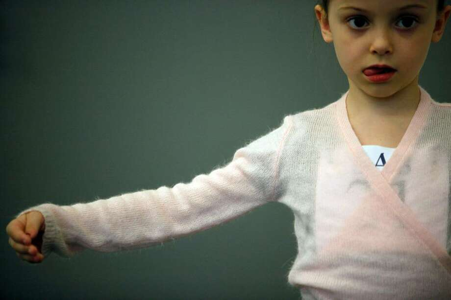 Lily Wilensky Hohn, 6, of Manhattan, warms up before auditioning for the School of American Ballet, Monday, April 19, 2010 in New York. The audition was the first in a series conducted for students between the ages of 6 and 10. (AP Photo/Mary Altaffer) Photo: Mary Altaffer, AP / AP