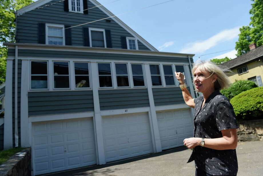 Greenwich Historical Society Executive Director Debra Mecky shows the new building that the Historical Society is acquiring beside the Bush-Holley House in the Cos Cob section of Greenwich, Conn. Monday, May 23, 2016. The Historical Society is purchasing the building adjacent to the current site and the parking lot and will remodel the building to its original 1900s style. There will also be a parking lot expansion, handicap accessibility and the research library and archives building will be demolished to create more open green space. Photo: Tyler Sizemore / Hearst Connecticut Media / Greenwich Time