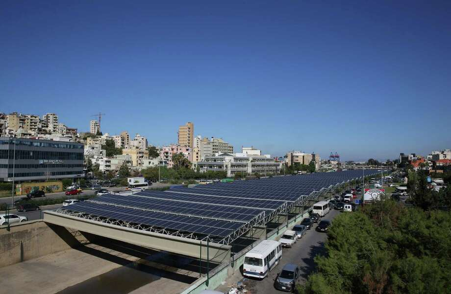 The Beirut River Solar Snake project in Lebanon uses water-based solar panels and stretches across 30 meters of the Beirut River. Companies and communities across the globe are turning to these panels to generate energy and save money.  Photo: JOSEPH EID, Staff / This content is subject to copyright.