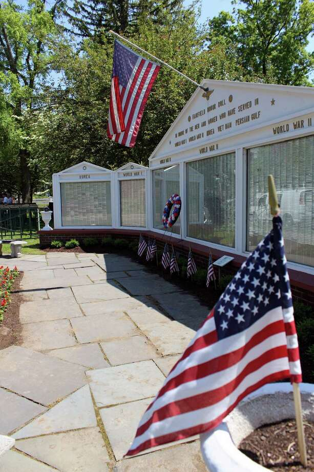 The Honor Roll at the Town Hall Green is ready for Monday's Memorial Day parade, which steps off at South Pine Creek and Post roads at 10 a.m. Photo: Genevieve Reilly / Hearst Connecticut Media / Fairfield Citizen