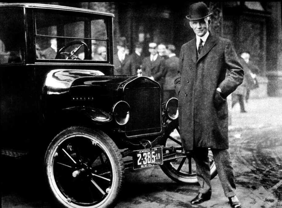 Henry Ford is shown with a ModelT in 1921. By doubling his workers' wages early in the 20th century,  Ford contributed to the creation of a middle-class America.  Photo: HO / THE HENRY FORD