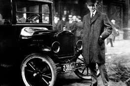 Henry Ford is shown with a Model T in 1921. By doubling his workers' wages early in the 20th century, Ford contributed to the creation of a middle-class America.