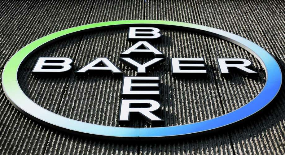 """FILE - This  Monday, May 23, 2016, file photo, shows the Bayer AG corporate logo displayed on a building of the German drug and chemicals company in Berlin. Monsanto is rejecting Bayer's $62 billion takeover bid, calling it """"incomplete and financially inadequate. However, the seed company suggested Tuesday, May 24, 2016, that a higher bid might be accepted, saying that it remains open to talks. (AP Photo/Markus Schreiber, File) ORG XMIT: NYBZ212 Photo: Markus Schreiber / Copyright 2016 The Associated Press. All rights reserved. This m"""