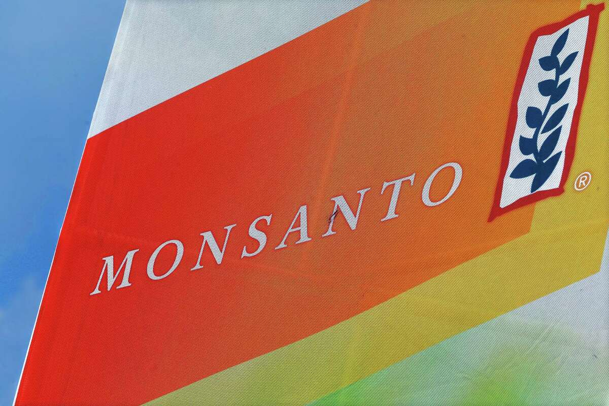 FILE - This Aug. 31, 2015, file photo, shows the Monsanto logo seen at the Farm Progress Show in Decatur, Ill. Monsanto is rejecting Bayer's $62 billion takeover bid, calling it