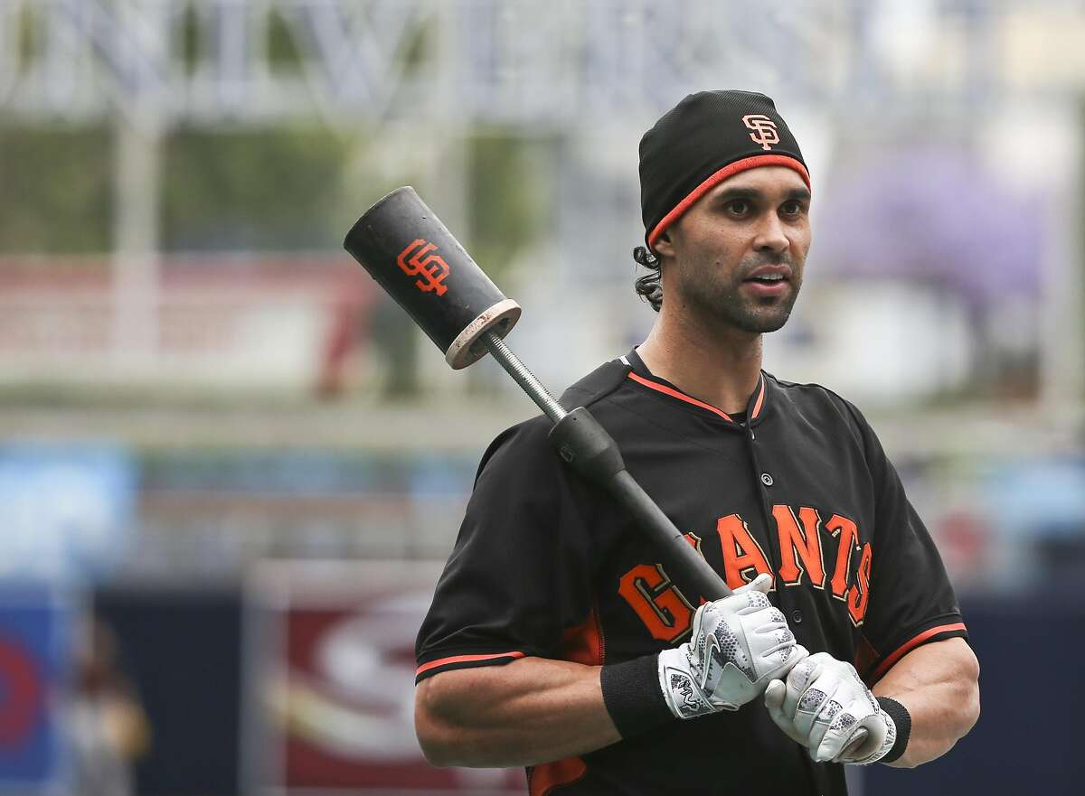 San Francisco Giants' Angel Pagan outside the batting cage prior to a baseball game against the San Diego Padres Tuesday, May 17, 2016, in San Diego. (AP Photo/Lenny Ignelzi)