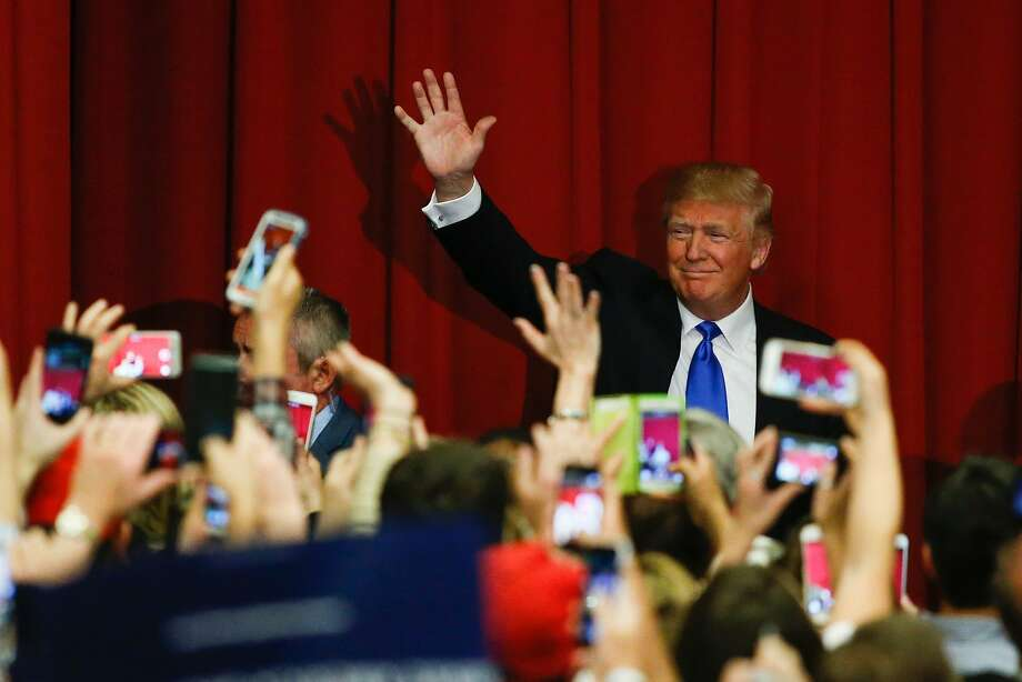 Republican presidential candidate Donald Trump waves to the crowd at a fundraising event in New Jersey last week. The billionaire has dropped his pledge to self-fund his campaign. Photo: EDUARDO MUNOZ ALVAREZ, AFP/Getty Images