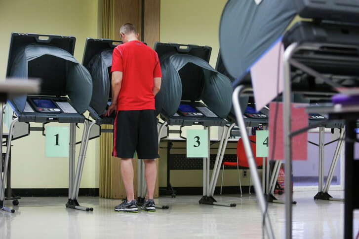 Rick Renshaw casts a ballot in the Democratic and Republican primary runoff election at the Metropolitan Multi-Services Center Tuesday, May 24, 2016 in Houston.