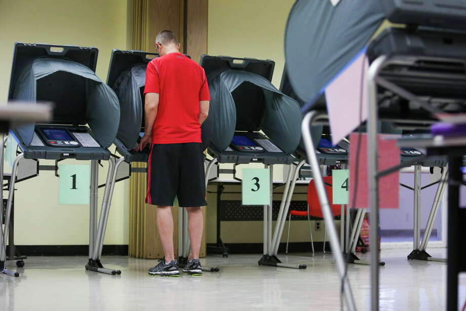 Rick Renshaw casts a ballot in the Democratic and Republican primary runoff election at the Metropolitan Multi-Services Center Tuesday, May 24, 2016 in Houston. Several state legislative races could be closer than expected in November because of voter turnout uncertainty in the presidential race. Photo: Michael Ciaglo, Houston Chronicle / © 2016  Houston Chronicle