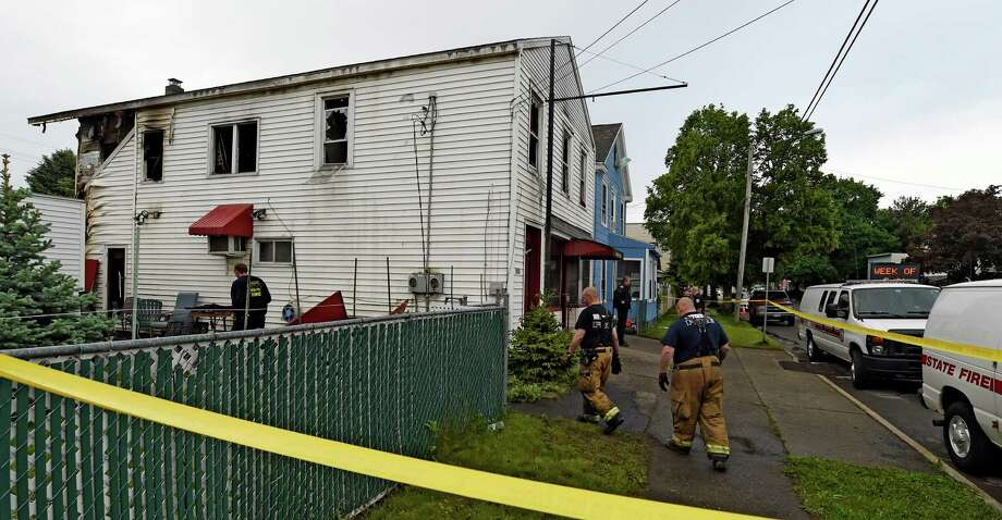 Fire investigators from State Fire investigate the cause of a fire at 350 3rd Avenue Tuesday morning May 23, 2016, in Watervliet, N.Y.    (Skip Dickstein/Times Union) Photo: SKIP DICKSTEIN
