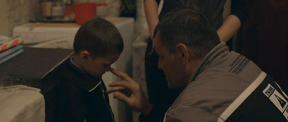 "Ukrainian pastor Gennadiy Mokhnenko helps children in the documentary ""Almost Holy"" Photo: Courtesy The Orchard"