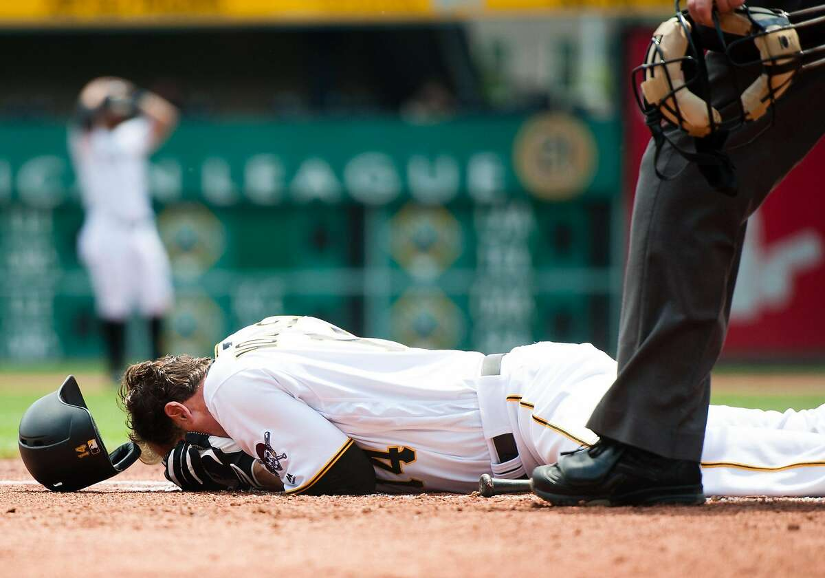 PITTSBURGH, PA - MAY 23: Ryan Vogelsong #14 of the Pittsburgh Pirates lays on the ground after being hit in the head by a pitch thrown by Jordan Lyles #24 of the Colorado Rockies in the second inning during the game at PNC Park on May 23, 2016 in Pittsburgh, Pennsylvania. (Photo by Justin Berl/Getty Images) ***BESTPIX***