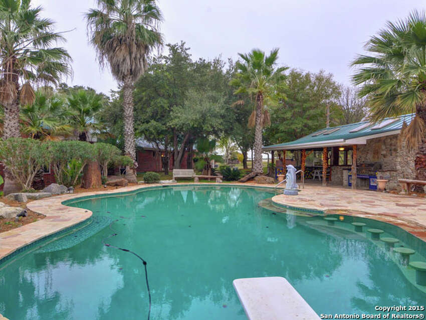 This 18-acre property in New Braunfels includes a six-bedroom home, a Keith Zars pool with a swim-up bar, a pond, a guest home and a greenhouse. The foreclosure is listed at $1.25 million.