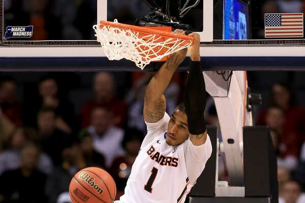 OKLAHOMA CITY, OKLAHOMA - MARCH 18:  Gary Payton II #1 of the Oregon State Beavers dunks the ball in the first half while taking on the Virginia Commonwealth Rams in the first round of the 2016 NCAA Men's Basketball Tournament at Chesapeake Energy Arena on March 18, 2016 in Oklahoma City, Oklahoma.  (Photo by Tom Pennington/Getty Images)