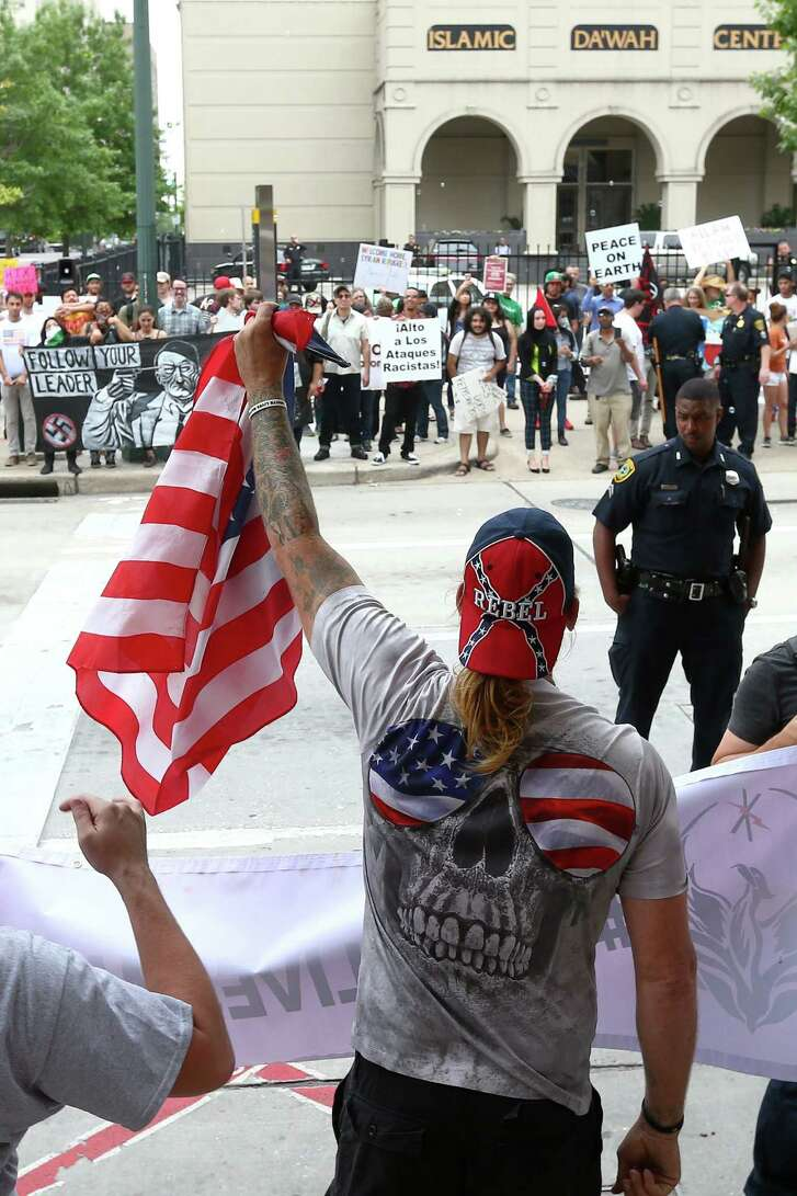 """Show me your patriotism,"" a protester who referred to himself as ""Doug,"" center, yells at counter-protesters at the Islamic Da'Wah Center, Saturday, May 21, in Houston. ""Equality and social justice aren't necessarily a bad thing, but they don't have the interests of the Houston community in mind,"" he said. ""This is the U.S., not Saudi Arabia. This doesn't have anything to do with Texas social justice."" ( Jon Shapley / Houston Chronicle )"