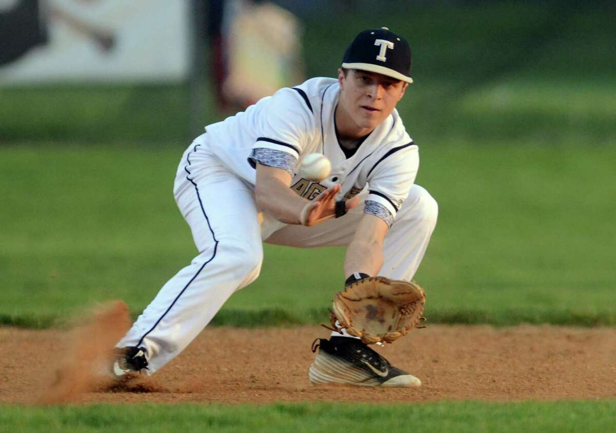 Trumbull's Danny Ruchalski eyes a Stamford grounder during baseball action in Trumbull, Conn., on Thursday May 12, 2016.