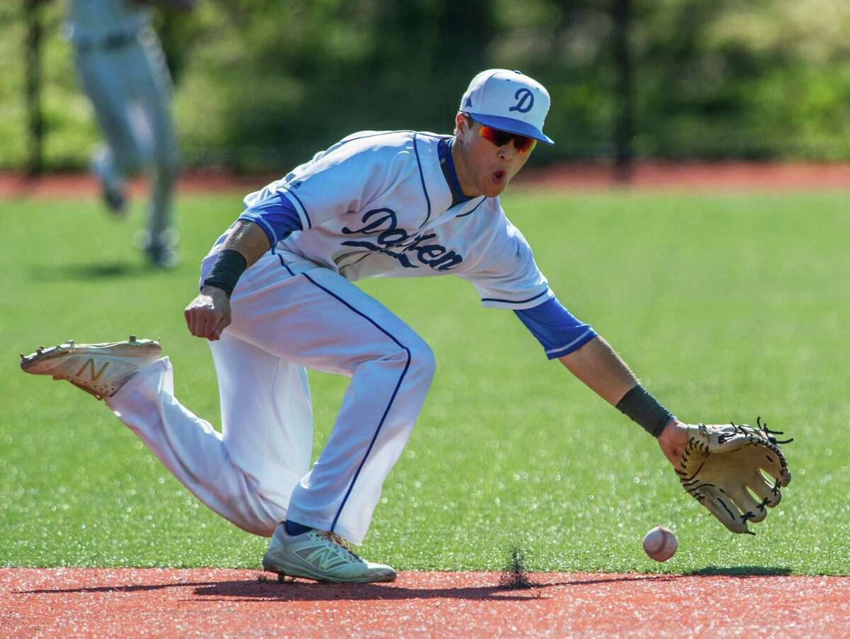 Darien High School shortstop Richard Brereton fields a ground ball during a baseball game against Greenwich High School played at Darien High School, Darien, CT on Monday, May 16, 2016.