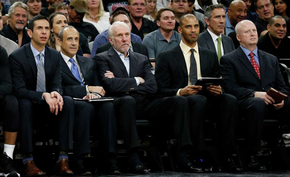 Spurs coaches James Borrego (second from left), Ettore Messina, Gregg Popovich, Ime Udoka and trainer Will Sevening watch the team against the Memphis Grizzlies at the AT&T Center in Game 2 of the first round of Western Conference playoffs on Tuesday, Apr. 19, 2016. Spurs defeated the Grizzlies, 94-68. (Kin Man Hui/San Antonio Express-News)