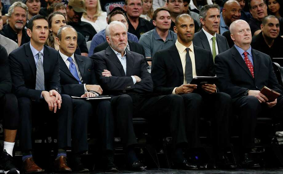 Spurs coaches James Borrego (second from left), Ettore Messina, Gregg Popovich, Ime Udoka and trainer Will Sevening watch the team against the Memphis Grizzlies at the AT&T Center in Game 2 of the first round of Western Conference playoffs on Tuesday, Apr. 19, 2016. Spurs defeated the Grizzlies, 94-68. (Kin Man Hui/San Antonio Express-News) Photo: Kin Man Hui, Staff / ©2016 San Antonio Express-News