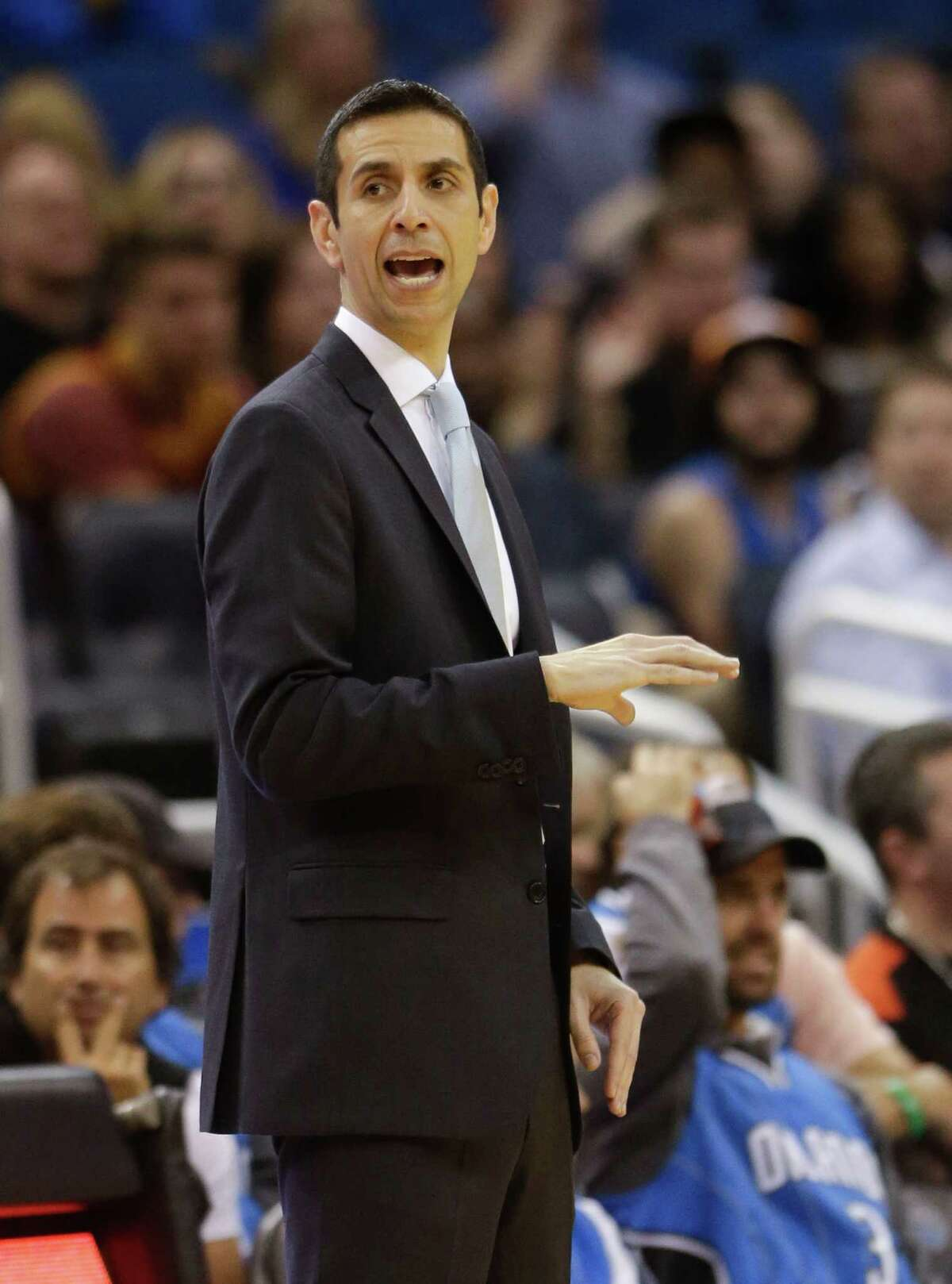 Orlando Magic interim head coach James Borrego directs his players on the court during the second half of an NBA basketball game against the Cleveland Cavaliers, Sunday, March 15, 2015, in Orlando, Fla. Cleveland won 123-108. (AP Photo/John Raoux)