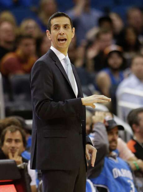 Orlando Magic interim head coach James Borrego directs his players on the court during the second half of an NBA basketball game against the Cleveland Cavaliers, Sunday, March 15, 2015, in Orlando, Fla. Cleveland won 123-108. (AP Photo/John Raoux) Photo: John Raoux, STF / AP