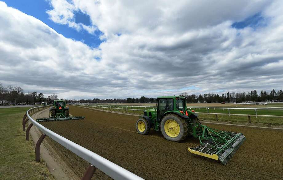Tractors harrow the Oklahoma Training Center track across from Saratoga Race Course on Tuesday, April 12, 2016, in Saratoga Springs, N.Y.    (Skip Dickstein/Times Union) Photo: SKIP DICKSTEIN