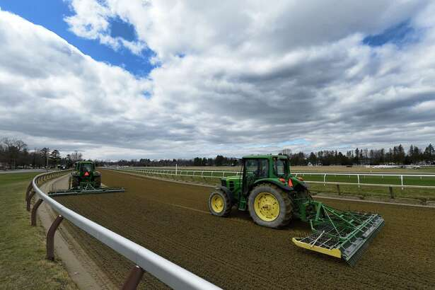Tractors harrow the Oklahoma Training Center track across from Saratoga Race Course on Tuesday, April 12, 2016, in Saratoga Springs, N.Y.    (Skip Dickstein/Times Union)