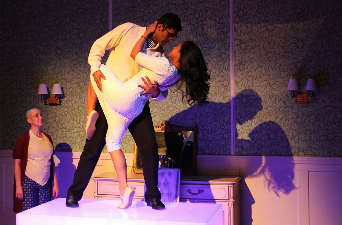 The Husband, (Kunal Prasad) and The Wife, (Carina Lastimosa), share a moment of passion by the seaside. Photo by Rob Melrose