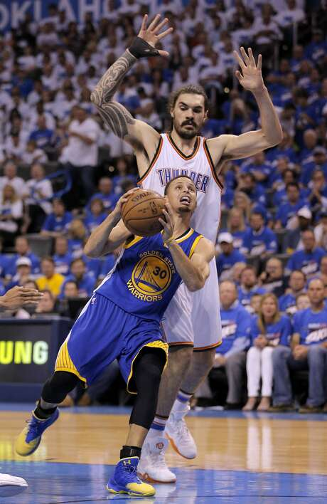 Stephen Curry (30) tries to drive around Steven Adams (12) during the second half as the Golden State Warriors played the Oklahoma City Thunder in Game 3 of the Western Conference Finals  at Chesapeake Energy Arena in  Oklahoma City, Okla., on Sunday, May 22, 2016. Photo: Carlos Avila Gonzalez, The Chronicle