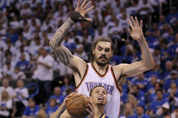 Stephen Curry (30) tries to drive around Steven Adams (12) during the second half as the Golden State Warriors played the Oklahoma City Thunder in Game 3 of the Western Conference Finals  at Chesapeake Energy Arena in  Oklahoma City, Okla., on Sunday, May 22, 2016.