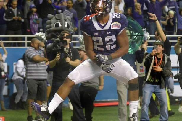 TCU running back Aaron Green celebrates after scoring a touchdown against Oregon in the 2016 Valero Alamo Bowl. A reader says Derrick Fox, president and CEO of the Alamo Bowl, makes too much money, especially compared to public officials with more important duties.