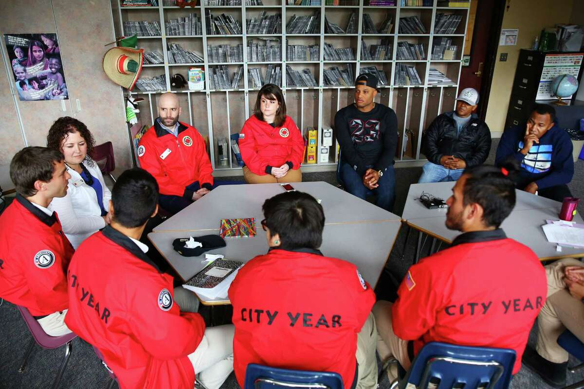 Seattle Mariner Robinson Cano talks with members of the AmeriCorps City Year team at Concord International School, Tuesday, May 24, 2016. Cano sponsors the City Year team at Concord as they work with bi-lingual students as peer mentors.