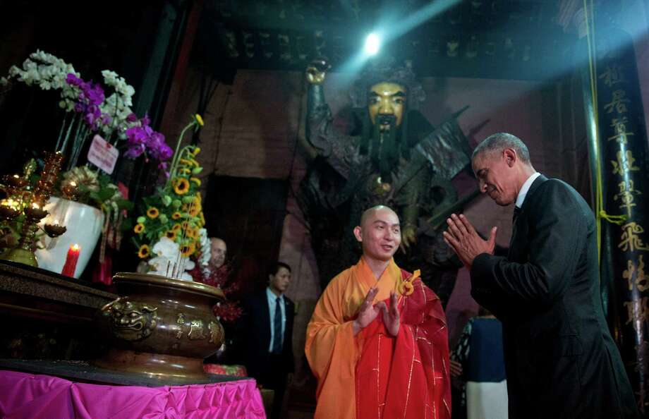 President Barack Obama visited the Jade Emperor Pagoda, one of the most-visited cultural destinations in Ho Chi Minh City, Vietnam, with abbot Thich Minh Thong on Tuesday.  Photo: Carolyn Kaster, STF / Copyright 2016 The Associated Press. All rights reserved. This material may not be published, broadcast, rewritten or redistribu