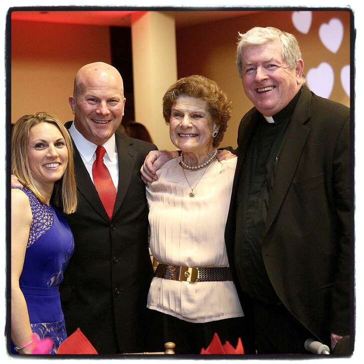 Wendy Kleinman (left) with her fiancŽ, SFPD Chief Greg Suhr, his mom, Sharon Suhr and SFPD Chaplain Fr. Mike Healy at the Banner of Love Gala. May 2015. By Paul Totah.