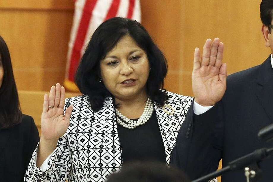Four new members are sworn in by Judge Irene Rios to the board of managers during a public meeting for Edgewood ISD at the Guerra Conference Center on May 24, 2016.  From left are Richard Santoya, Amanda Gonzalez, Stella Camacho and Roy Soto. Photo: TOM REEL, STAFF / SAN ANTONIO EXPRESS-NEWS / 2016 SAN ANTONIO EXPRESS-NEWS