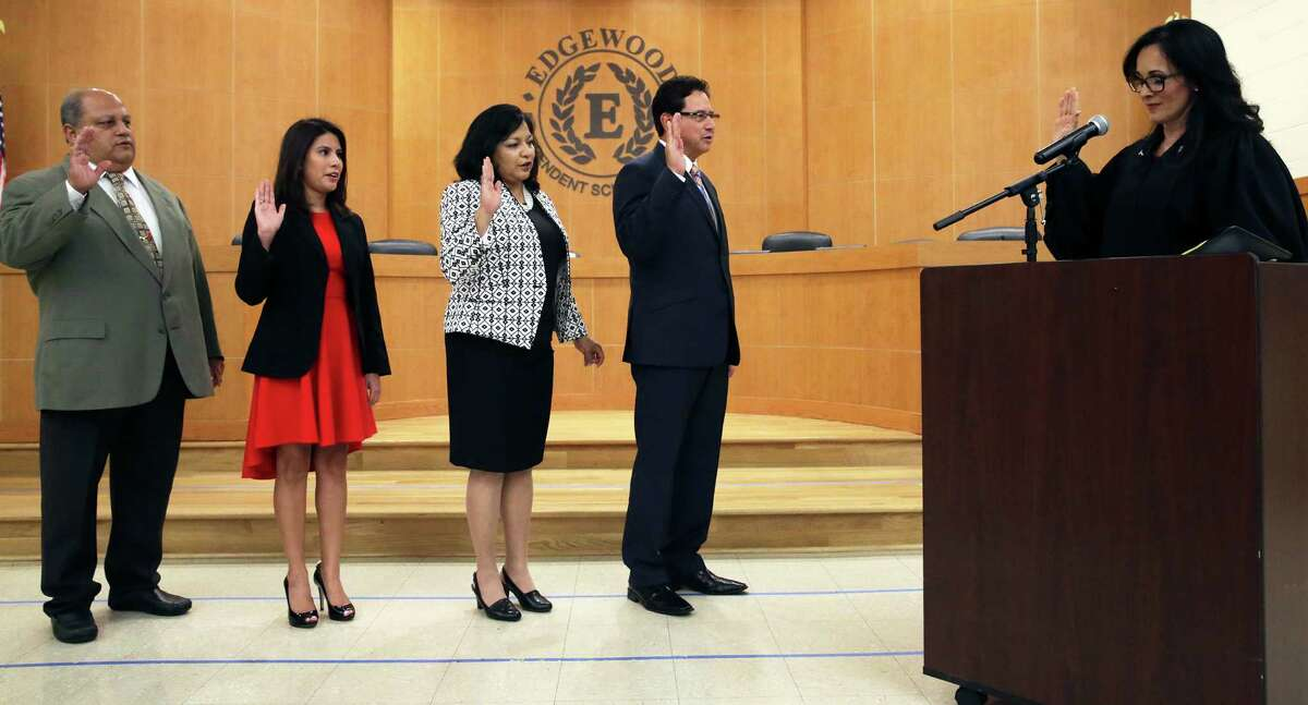 Four new members are sworn in by Judge Irene Rios to the board of managers during a public meeting for Edgewood ISD at the Guerra Conference Center on May 24, 2016. From left are Richard Sontoyo, Amanda Gonzalez, Stella Camacho and Roy Soto.