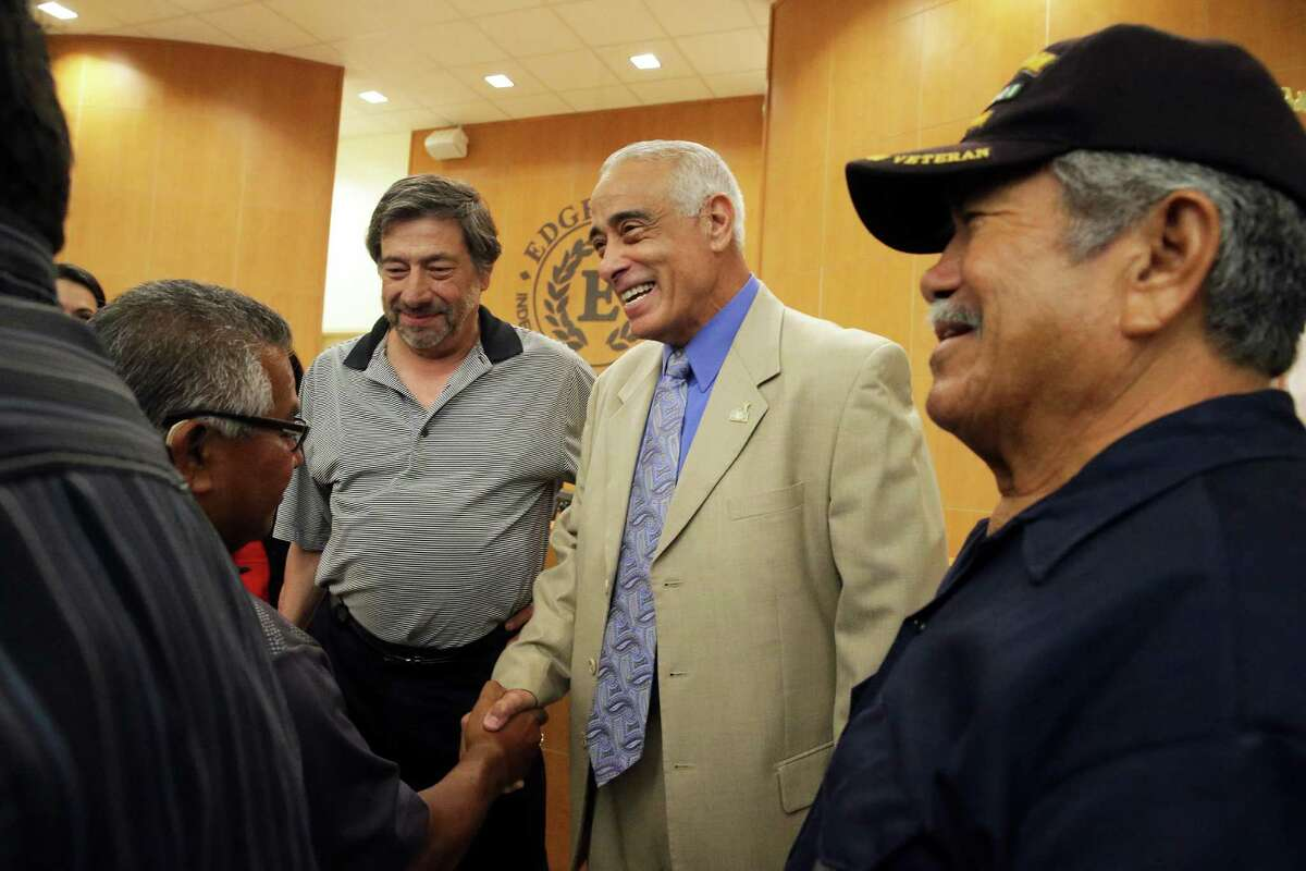Superintendent Sylvester Perez greets the crowd as four new members are sworn in to the board of managers during a public meeting for Edgewood ISD at the Guerra Conference Center on May 24, 2016.