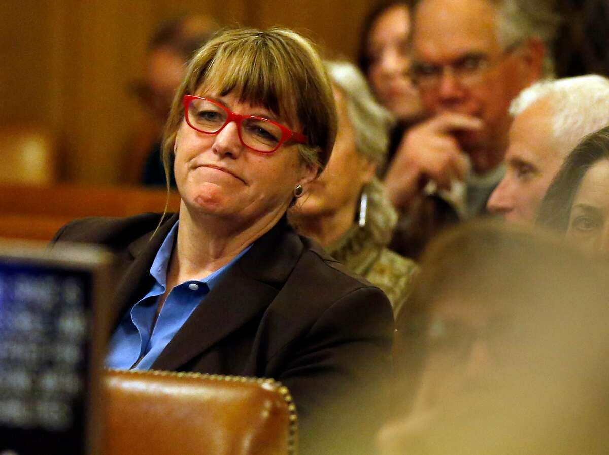 San Francisco Sheriff Vicki Hennessy listens as SF Supervisor John Avalos speaks about new sanctuary guidelines during meeting at City Hall in San Francisco, Calif., on Tuesday, May 24, 2016.