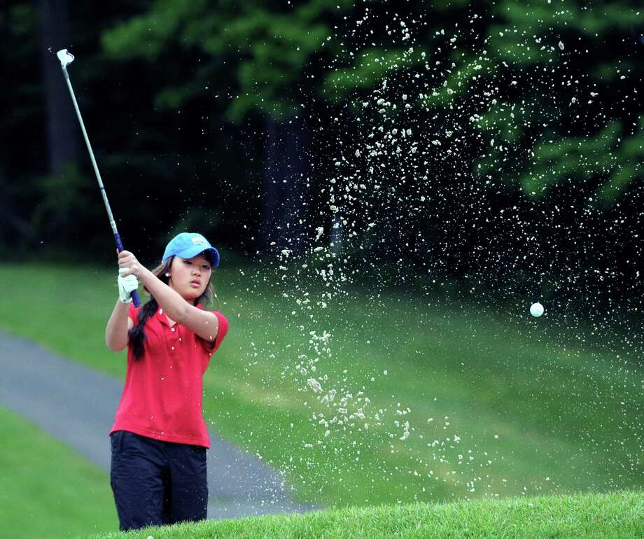 Grace Sunoo of Greenwich shoots out of a bunker near the second green during Tuesday's match against Staples at the Griffith E. Harris Golf Course in Greenwich. Photo: Bob Luckey Jr. / Hearst Connecticut Media / Greenwich Time
