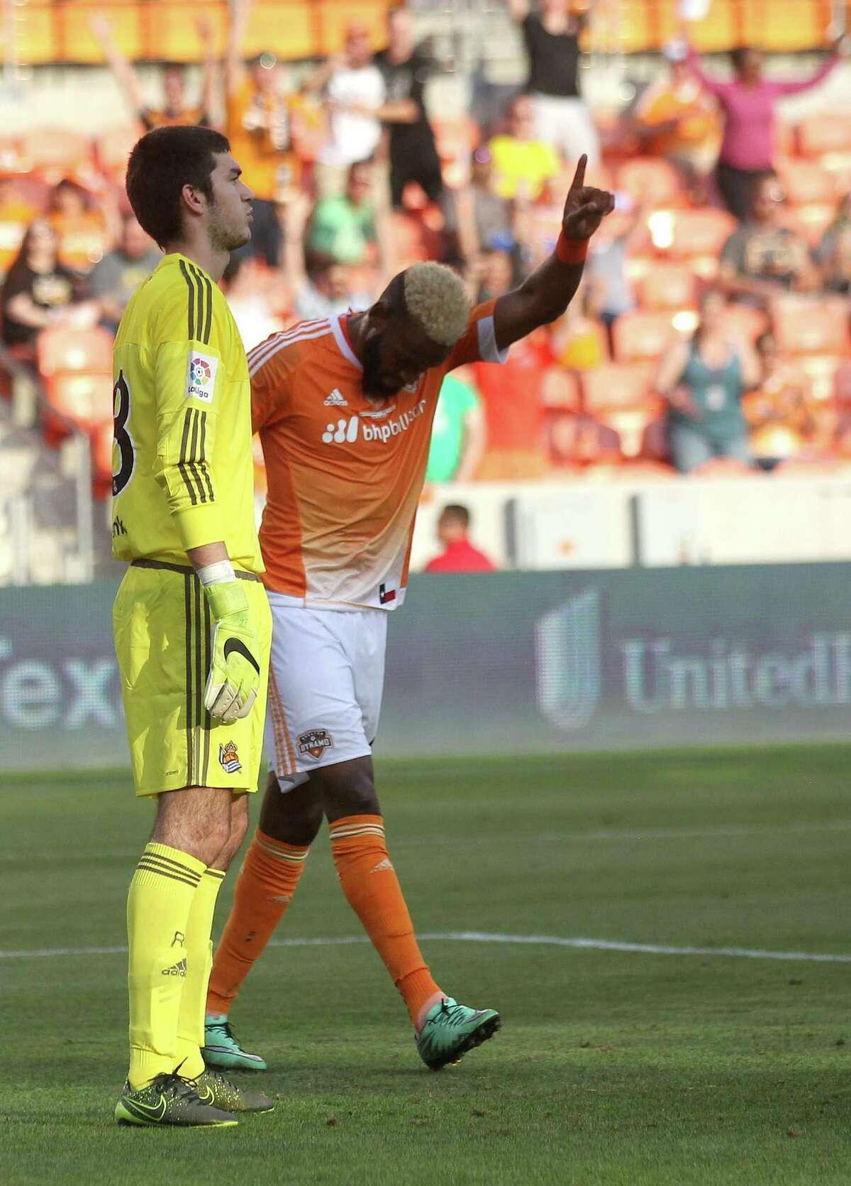 Houston Dynamo defender Sebastian Ibeagha (34) reacts to teammates Houston Dynamo midfielder David Rocha (6) goal in the first half in front of Real Sociedad goalkeeper Andre Bardaji (13) on Tuesday, May 24, 2016, in Houston.