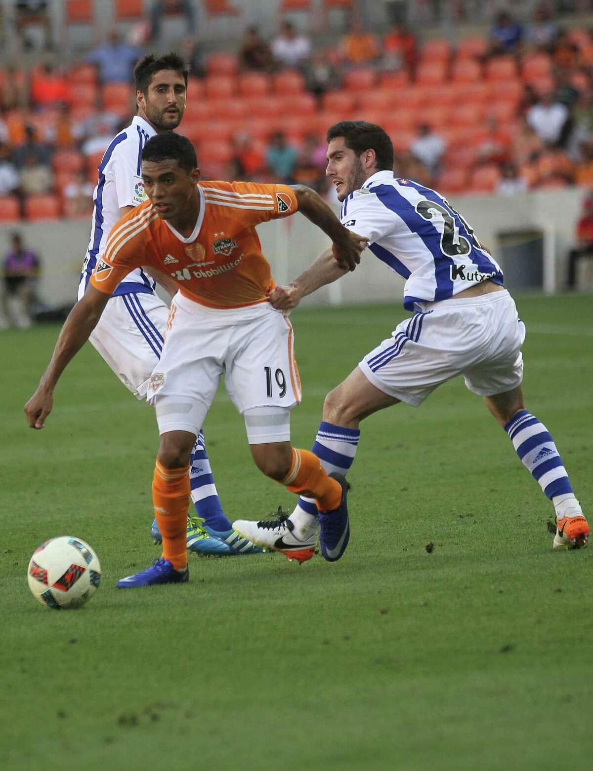 Real Sociedad defender Alberto De La Bella (24) holds onto Houston Dynamo forward Mauro Manotas (19) in the first half of the Charities Cup on Tuesday, May 24, 2016, in Houston.