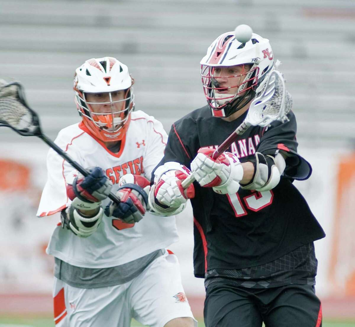 Ridgefield High School's William Carpenter tries to block the pass of New Canaan High School's Peter Swindell in the FCIAC boys lacrosse semifinal at Brien McMahon High School in Norwalk. Tuesday, May 24, 2016