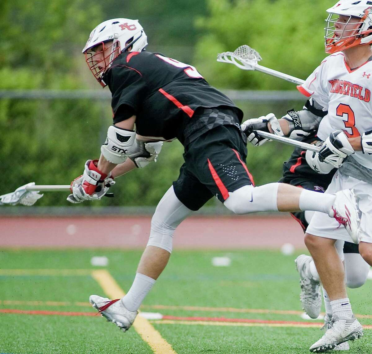 New Canaan High School's David Strupp fires the ball in the FCIAC boys lacrosse semifinal against Ridgefield High School, played at Brien McMahon High School in Norwalk. Tuesday, May 24, 2016