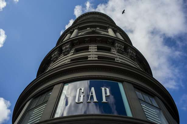 A bird flies over a Gap Inc. store in San Francisco, California, U.S., on Friday, May 13, 2016. Gap Inc. is scheduled to release earnings figures on May 19. Photographer: David Paul Morris/Bloomberg