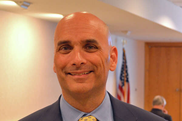 Matthew Maddox, a New Canaan attorney, gave a talk Wednesday at the New Canaan Library on marijuana.
