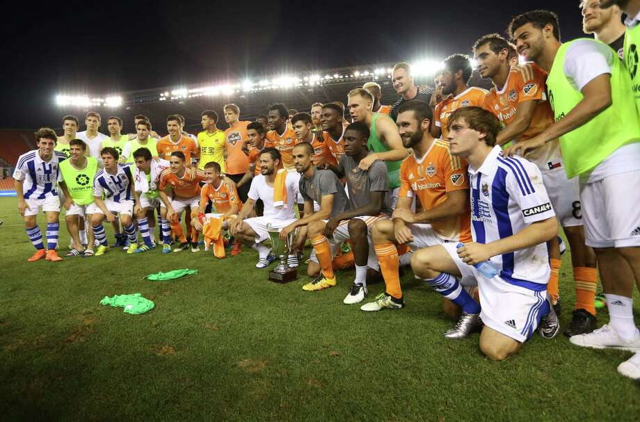 Both teams pose with the Dynamo Charities Cup after  Houston won the game against Real Sociedad 5-4 on penalty kicks on Tuesday, May 24, 2016, in Houston. Photo: Elizabeth Conley, Houston Chronicle / © 2016 Houston Chronicle