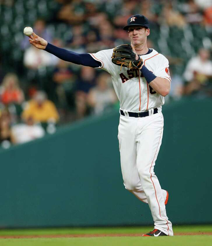 Houston Astros third baseman Colin Moran (8) makes the throw to first base as Baltimore Orioles third baseman Manny Machado grounded out during the third inning of an MLB baseball game at Minute Maid Park, Tuesday, May 24, 2016.