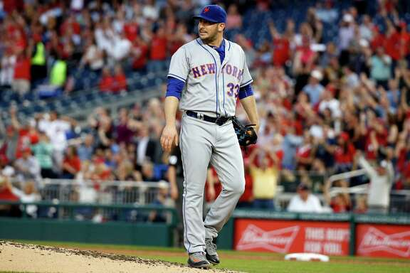 New York Mets starting pitcher Matt Harvey reacts after a solo home run by Washington Nationals' Anthony Rendon during the fourth inning of a baseball game at Nationals Park, Tuesday, May 24, 2016, in Washington. (AP Photo/Alex Brandon) ORG XMIT: NAT108