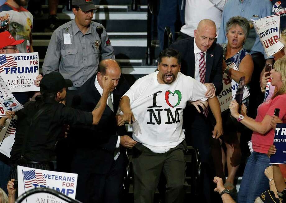 A protester is taunted by Trump supporters as he is removed during a speech by Republican presidential candidate Donald Trump at a campaign event in Albuquerque, N.M., Tuesday, May 24, 2016. Photo: Brennan Linsley, AP / Copyright 2016 The Associated Press. All rights reserved. This material may not be published, broadcast, rewritten or redistribu