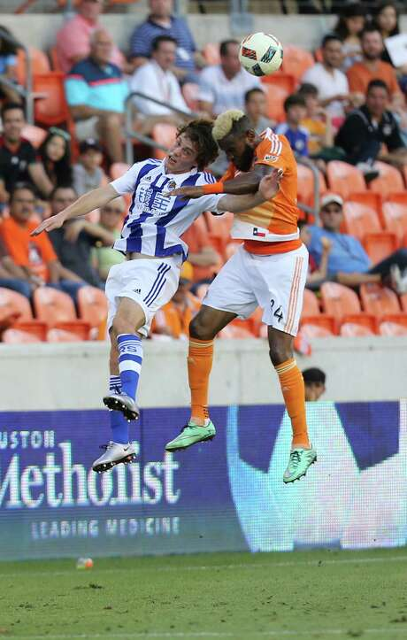 The Dynamo's Sebastian Ibeagha, right, battles Real Sociedad Jon Bautista. Photo: Elizabeth Conley, Staff / © 2016 Houston Chronicle